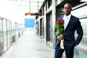 Businessman at Metro Holding Bouquet of Flowers — Stock Photo