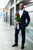 Happy Businessman Waiting at the Metro with Roses — Stock Photo