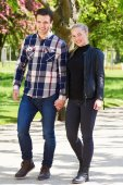 Attractive trendy couple enjoying a walk — Stock Photo