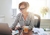 Successful female entrepreneur with a new business — Stock Photo
