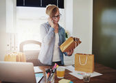 Motivated businesswoman placing orders on a phone — Stock Photo