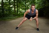 Athletic Man Doing Warm Up Exercise at the Park — Stock Photo