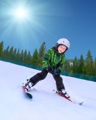 Little skier going down from snowy hill — Stock Photo