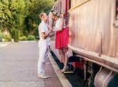 Couple kissing near train — Stock Photo