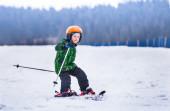 Little boy slides on skis — Stock Photo