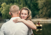 Love couple near the pond  — Stock Photo