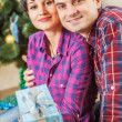 Couple with gift boxes — Stock Photo #55987601