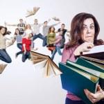 Mad faced teacher with folders — Stock Photo #58053279