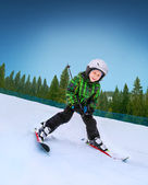 Little skier going down — Stock Photo