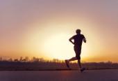 Running man silhouette — Stock Photo