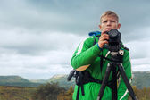 Photographer man in mountain — Стоковое фото