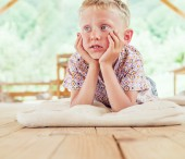 Boy  on the garden terrace — Stockfoto