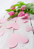 Pink tulips and hearts — Stock Photo