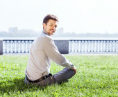 Young man relax on  lawn — Stock Photo