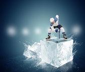 Hockey player on ice cube — Stock Photo