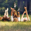 Teenagers lying on  lawn with guitar — Foto Stock #69581031