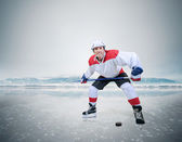 Smiling hockey player — Stock Photo