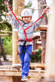 Boy in  equipment on rope track — 图库照片