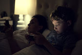 Mother with son using devices — Stock Photo