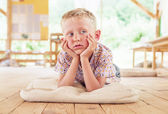 Boy lying on summer terrace — Stock Photo