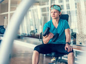 Young man in gym — Stock Photo