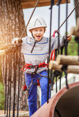 Happy boy on rope track — Stock Photo