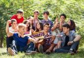 Young people singing with guitar — Stock Photo