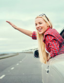 Young woman in car window — Stock Photo