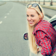 Woman looking out from car window — Stock Photo #77040513