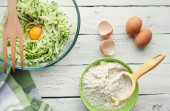 Ingredients for cooking zucchini pancakes — Stock Photo