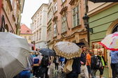 People walking on the rainy streets in Prague — Stock Photo