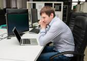 Young handsome man with computer in the office. Programming — Stock Photo