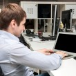 Young handsome man with computer in the office. Thinking over task in programming — Stock Photo #75692827