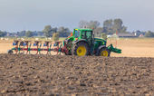 Tractor with Plough in the Field — Stock Photo