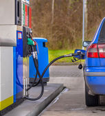 Refuelling blue car — Stock Photo