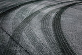 Abstract asphalt tires tracks background — Stock Photo