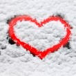 Red heart in snow — Stock Photo #77260070