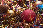 Christmas ball  and cones in multicolored tinsel — Foto de Stock