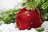 Christmas red ball in snow — Stok fotoğraf