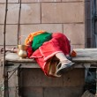Indian woman sleeping on wooden table in the street — Stock Photo #66980727