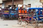 Many bicycle rickshaws on parking — Stok fotoğraf