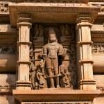 Stone carved sculpture of Male Deity on Lakshmana temple. Khajuraho — Stock Photo #70209457