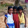 Three Indian girls on the street in fishing village — Stock Photo #76603711