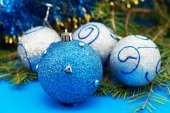 Christmas tree branch with blue baubles — Stock Photo