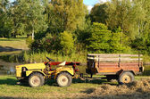 Old tractor in the park — Stock Photo