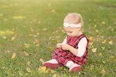 Toddler girl on the field  — Stockfoto