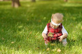 Toddler girl on the field  — Stock Photo