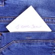 Sticker in back pocket blue jeans — Stock Photo #63035861