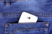 Part of cellphone in blue jeans pocket — Stockfoto