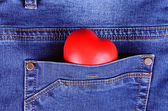 Read heart shape in blue jeans pocket — Stock Photo
